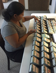 Advance Opportunities employee collating NEATLINGS Household Chore Decks.